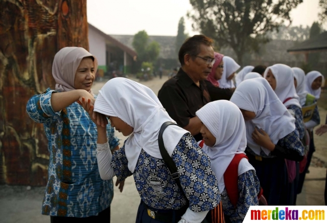 20150910140158-sekolah-di-palembang-diliburkan-gara-gara-asap-makin-berbahaya-001-nfi-2
