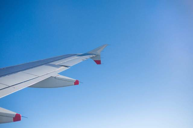 airplane-wing-and-bright-sky-through-an-airplane-window_free_stock_photos_picjumbo_HNCK2580-2210x1474